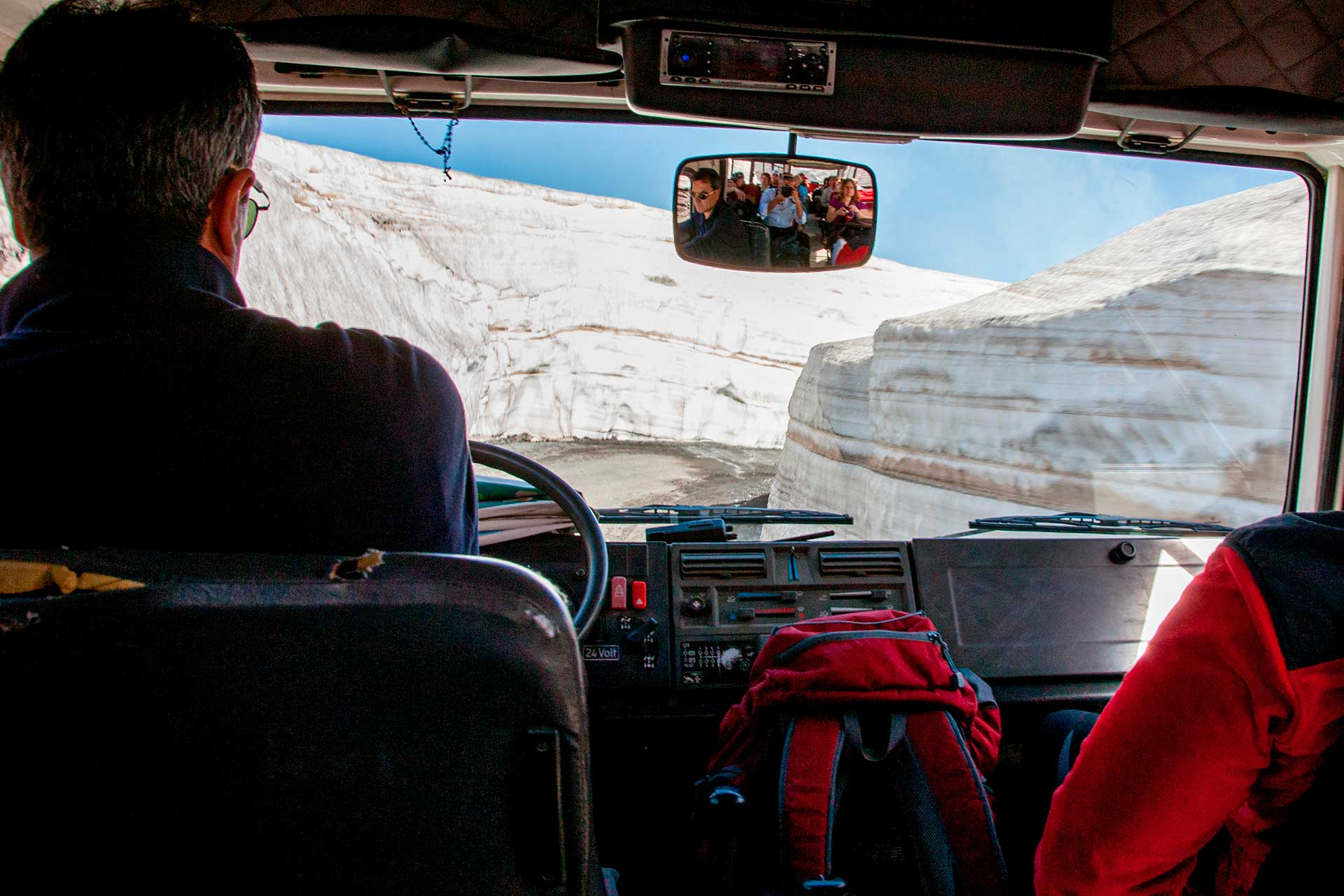 The off-road vehicle climbs up a road, which despite being the month of May, had two snow walls more than 4 meters high on either side.