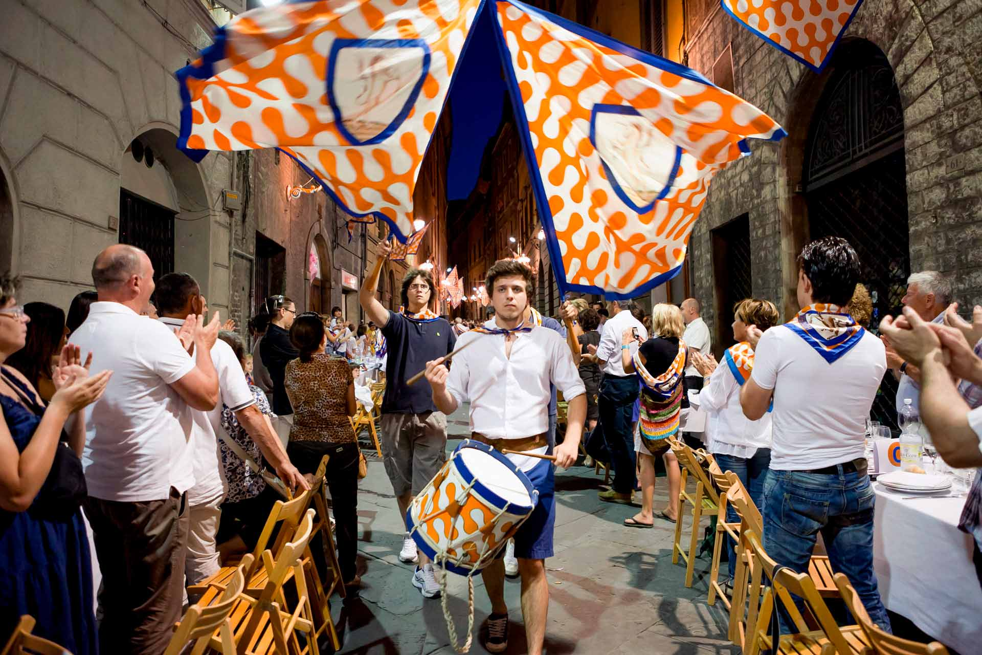 DINNER IN THE CONTRADA - The General Rehearsal dinner is the occasion in which one can most deeply penetrate the essence of the Palio.